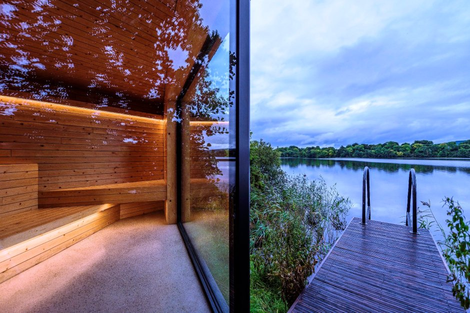 A view of a lake and deck from inside the spa at Lough Erne, Northern Ireland.