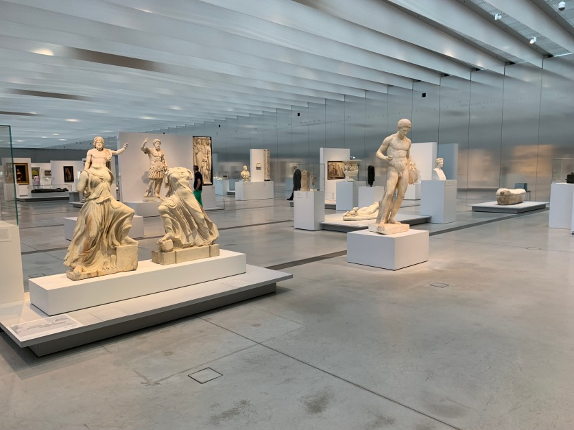 The interior of the Louvre Lens Museum at Arras, Northern France showing art works and statues.